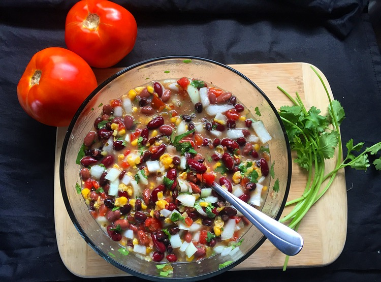 Amazing three-bean salad: At first bite of this dish, you will be instantly in love. The warm rice, topped with the chilled bean salad and spicy sauces is just heavenly.