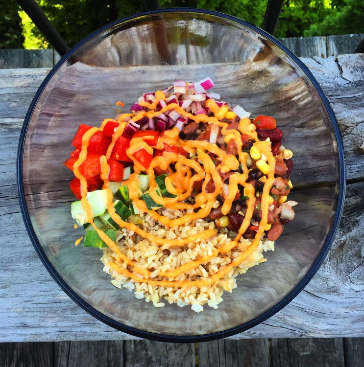 Buddha bowl: At first bite of this dish, you will be instantly in love. The warm rice, topped with the chilled bean salad and spicy sauces is just heavenly.